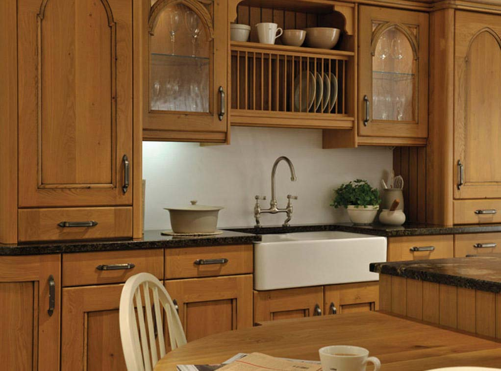 Croft kitchen showing butler sink and taps, a classic farm house, rustic style fitted kitchen door.