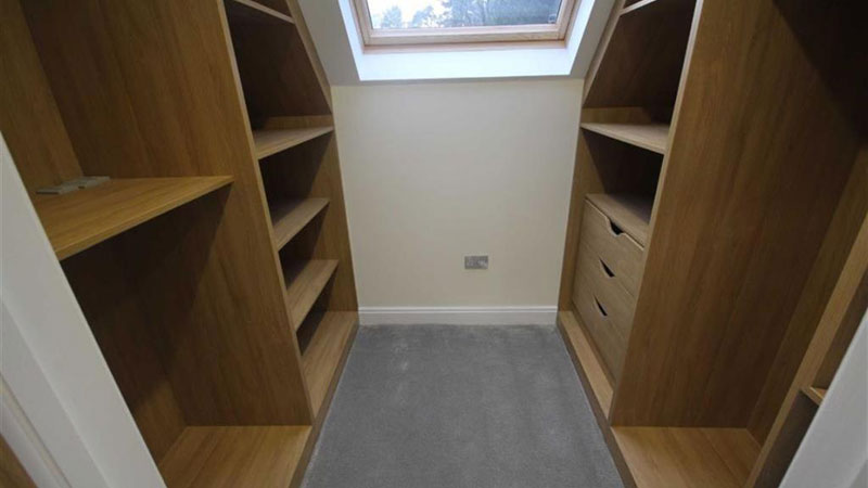 Made-to-measure bedroom furniture - a walk in fitted wardrobe designed and installeld by Meridien Interiors